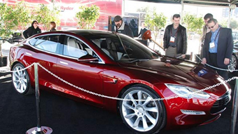 A Tesla car with a plunger assassin