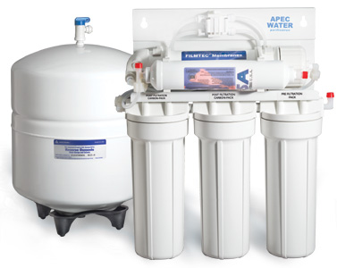 A marketing image of a reverse osmosis filter.  There's a storage tank that holds about four gallons on the left, there's a five stage filtering system on the right.  The first three stages are long tubes along the bottom, they filter out sediment and shit.  The fourth stage is the reverse osmosis membrane.  It's the branes of the operation, but it's hidden behind the fifth stage and sitting on a small platform just above those first three cylinders.  Stage four and five are squat horizontal cylinders.  Stage five modifies water flavor.