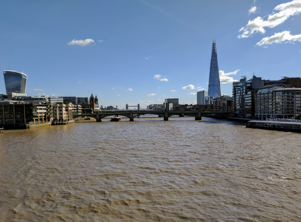 This view is from the Millennium Bridge, looking past Southwark Bridge, London Bridge, and towards Tower Bridge. Millennium Bridge is the cool metal pedestrian bridge...