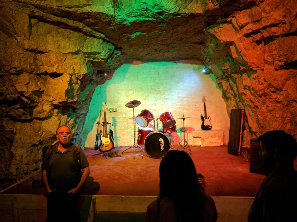 These mines served as bomb-shelter for Londonners. They needed a place to have entertainment, and this was it. The Beatles played on this tiny, multicolored stage, among many other famous bands.