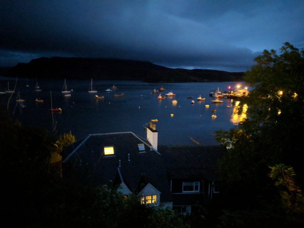 Portree's Harbour at night, from a main street that curls around the town