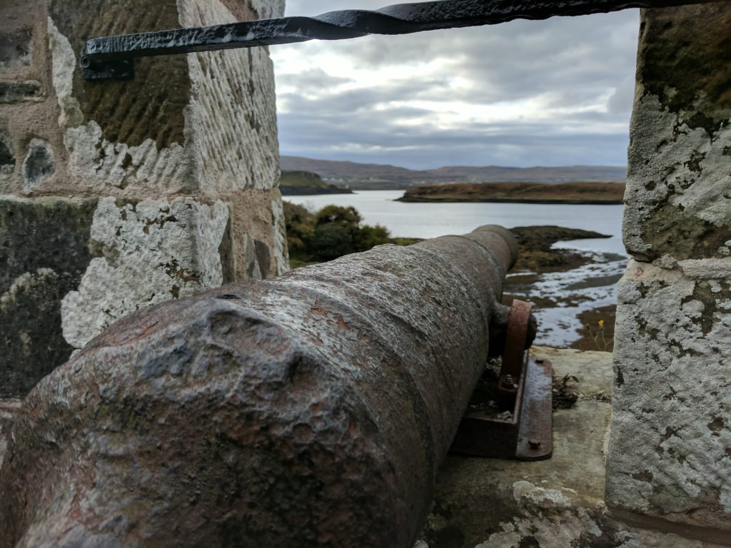 A cannon looking out towards the water at Dunvegan Castle